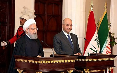 Iranian President Hassan Rouhani (left) and Iraqi President Barham Salih prepare to address the media in Baghdad, March 11, 2019. (AP Photo/Khalid Mohammed)