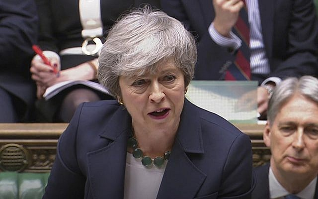 Britain's Prime Minister Theresa May speaks during Prime Minister's Questions inside the House of Commons in London, March 13, 2019 (House of Commons/PA via AP)