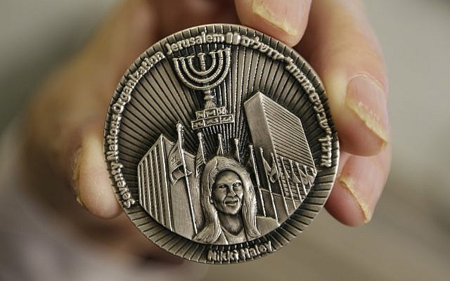 This photo from March 13, 2019, shows a coin emblazoned with the face of Nikki Haley, US President Donald Trump's former ambassador to the United Nations, to commemorate her defense of Israel in the United Nations, in Jerusalem. (AP Photo/Dusan Vranic)
