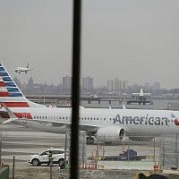 An American Airlines Boeing 737 MAX 8 sits at a boarding gate at LaGuardia Airport, March 13, 2019, in New York (AP Photo/Frank Franklin II)