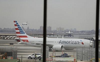 An American Airlines Boeing 737 MAX 8 sits at a boarding gate at LaGuardia Airport, March 13, 2019, in New York. (AP Photo/Frank Franklin II)