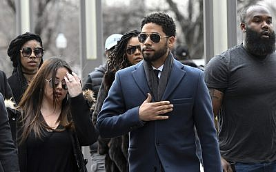 Empire actor Jussie Smollett, center, arrives at the Leighton Criminal Court Building for his hearing on March 14, 2019, in Chicago (AP Photo/Matt Marton)