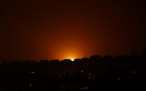 Illustrative: An explosion caused by Israeli airstrikes is seen on Gaza City, early Friday, March 15, 2019. Israeli warplanes attacked targets in the southern Gaza Strip early Friday in response to a rare rocket attack on the Israeli city of Tel Aviv (AP Photo/Adel Hana)