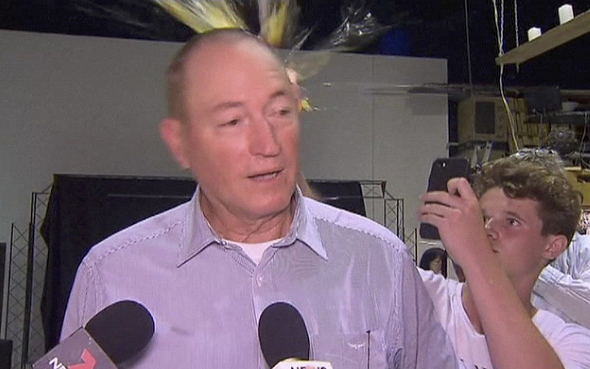 Fraser Anning slaps teenager after being hit over the head with egg