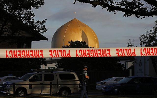 A police officer stands guard in front of the Masjid Al Noor mosque in Christchurch, New Zealand, March 17, 2019. (Vincent Yu/AP)