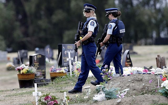 Armed police patrol a cemetery near Muslim graves in Christchurch, New Zealand, March 18, 2019. (AP/Mark Baker)