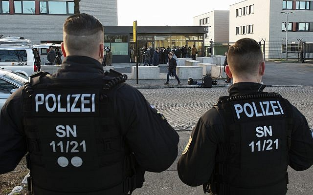 Illustrative: German police stand in front of a Dresden courthouse where a trial against a Syrian jihadist is set to begin, in Dresden, Germany, Monday, March 18, 2019. (Jens Meyer/AP)