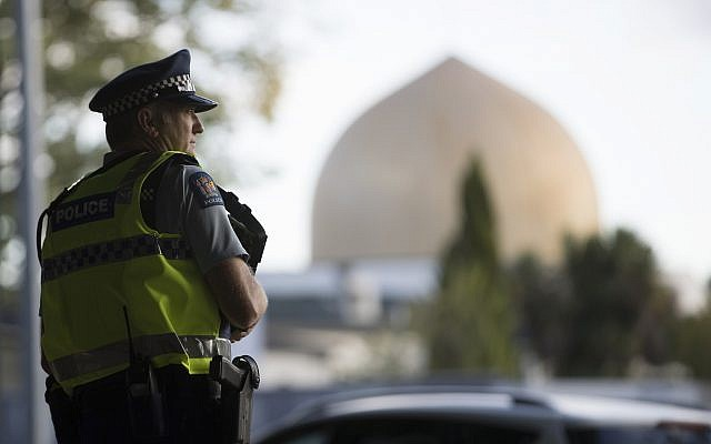 A police official stands guard in front of the Al Noor mosque in Christchurch New Zealand