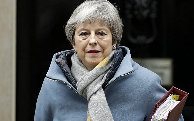 Britain's Prime Minister Theresa May leaves 10 Downing Street to attend the weekly Prime Ministers' Questions session, at parliament in London, March 20, 2019. (AP Photo/Matt Dunham)