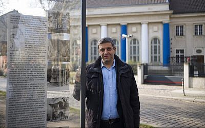 Palestinian-German politician Raed Saleh poses for a photo near a remembrance plague with information and a photo of the former Fraenkelufer synagogue, in Berlin, March 20, 2019.(AP Photo/Markus Schreiber)