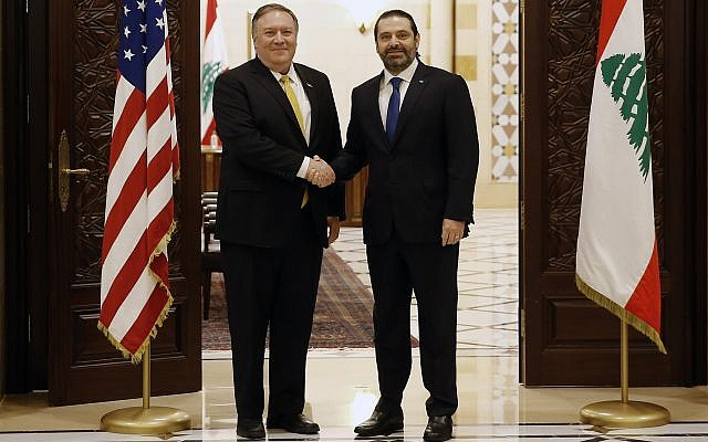 Lebanese Prime Minister Saad Hariri shakes hands with US Secretary of State Mike Pompeo, left, in Beirut, Lebanon, March 22, 2019. (AP Photo/Bilal Hussein)