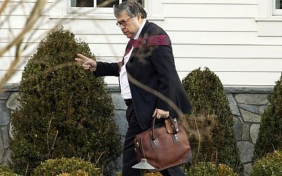 Attorney General William Barr leaves his home in McLean, Va., on Friday, March 22, 2019.  (AP Photo/Jose Luis Magana)