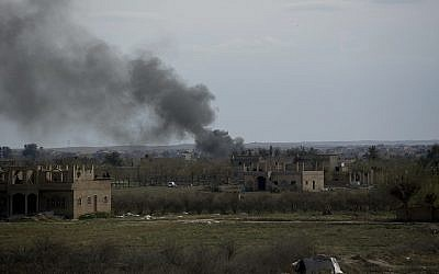 Smoke rises from a strike on Baghouz, Syria, on the Islamic State group's last piece of territory on March 22, 2019. (AP Photo/Maya Alleruzzo)
