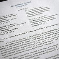 A copy of a letter from Attorney General William Barr advising Congress that Special Counsel Robert Mueller has concluded his investigation, is shown on March 22, 2019 in Washington. (AP Photo/Jon Elswick)