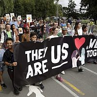 "Students and members of the public walk in the ""March for Love"" following last week's mosque attacks in Christchurch, New Zealand, March 23, 2019. (AP/Mark Baker)"