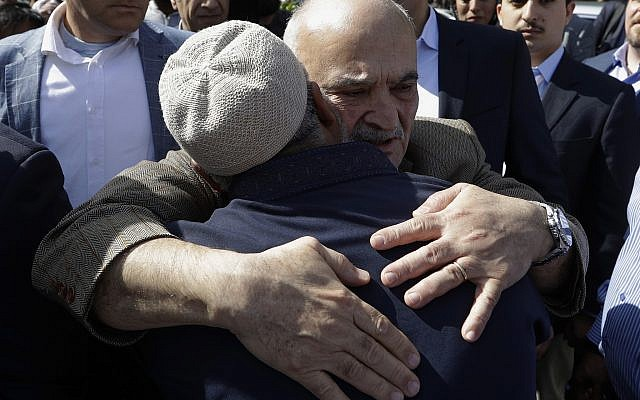 His Royal Highness Prince El Hassan bin Talal Hashemite, of the Kingdom of Jordan, embraces a worshiper outside the Al Noor mosque in Christchurch, New Zealand, March 23, 2019 (AP Photo/Mark Baker)