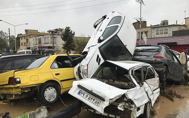 Vehicles are piled up on the street after a flash flood in the southern city of Shiraz, Iran, March 25, 2019. (AP Photo/Amin Berenjkar/Mehr News Agency)