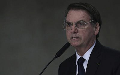 Brazil's President Jair Bolsonaro speaks during ceremony at the Planalto Presidential Palace in Brasilia, Brazil, March 25, 2019. (AP Photo/Eraldo Peres)