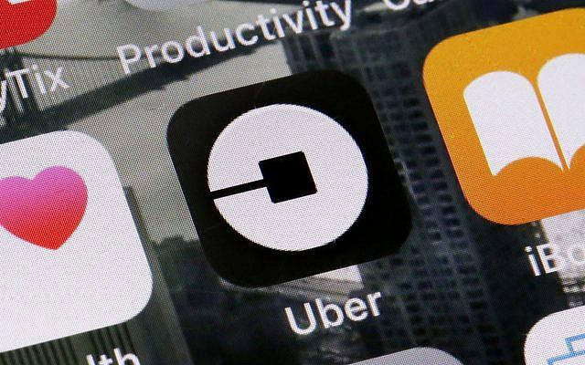 Illustrative - the Uber app on a phone in New York. (AP/Richard Drew, File)