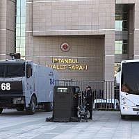 Security cars and a police officer outside Istanbul's courthouse during the trial of Metin Topuz, a Turkish employee of the United States Consulate in Istanbul charged with espionage, March 26, 2019.  (AP/Mehet Guzel)