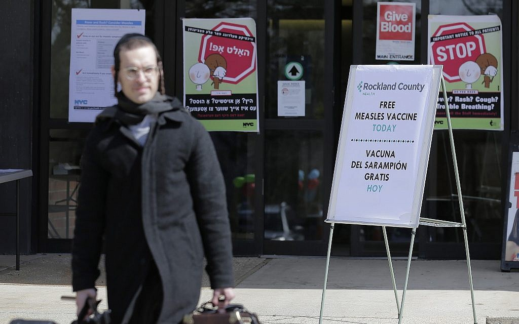 Signs about measles and the measles vaccine are displayed at the Rockland County Health Department in Pomona, New York, March 27, 2019 (AP Photo/Seth Wenig)