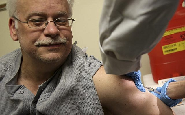 Steve Sierzega receives a measles, mumps and rubella vaccine at the Rockland County Health Department in Pomona, New York, March 27, 2019. (AP Photo/Seth Wenig)