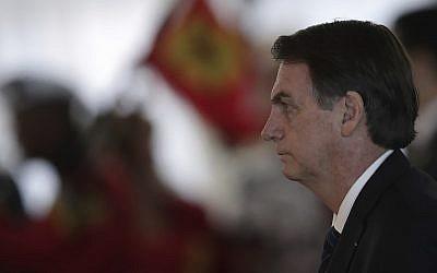 Brazil's President Jair Bolsonaro attends a military awards ceremony in Brasilia, Brazil, Thursday, March 28, 2019. (Eraldo Peres)