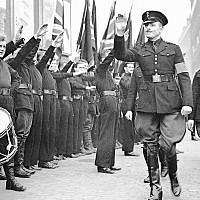 Sir Oswald Mosley, leader of the British Union of Fascists, inspects the ranks of blackshirts, in East London, on October 4, 1936. (AP Photo/Len Puttnam/Staff)