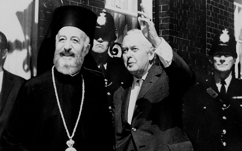 Illustrative: British prime minister Harold Wilson, right, waves to the media as he and Archbishop Makarios, deposed Cyprus president, pose with photographers outside No. 10 Downing Street in London, July 17, 1974.  (AP Photo)