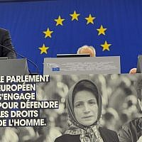 Martin Schultz, top left, president of the European Parliament delivers a statement during the awarding ceremony for the Sakharov Prize Wednesday, Dec 12, 2012 at the European Parliament in Strasbourg, eastern France, in front of pictures of Nasrin Sotoudeh and film director Jafar Panahi. (AP/Christian Lutz)