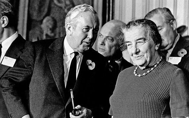 Harold Wilson, leader of Britain's Labor Party and Opposition leader, in conversation with Mrs. Golda Meir of Israel before the start of the Socialist International meeting at London's Churchill Hotel on November 11, 1973. (AP Photo)