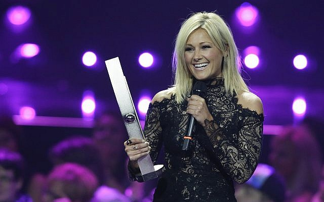 Helene Fischer receives the award for the most successful 'Crossover' artist during the 2016 Echo Music Awards in Berlin, April 7, 2016. (AP Photo/Markus Schreiber, Pool)