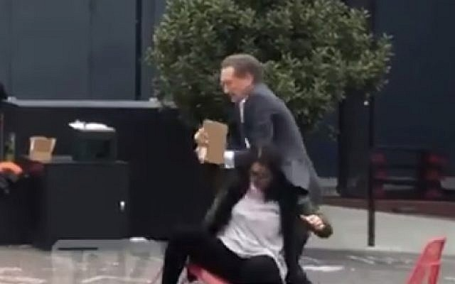 Larry Baer seen in a physical altercation with his wife Pam, in a video published March 1, 2019. (screen capture: TMZ)
