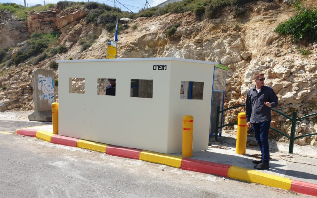 A protective barrier installed at a bus stop at the Givat Assaf Junction on March 20, 2019. (Menachem Bakush)