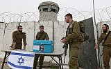 Illustrative: IDF soldiers vote in elections for Israel's 18th Knesset at a West Bank checkpoint near Bethlehem, February 9, 2009. (Nati Shohat/Flash 90)