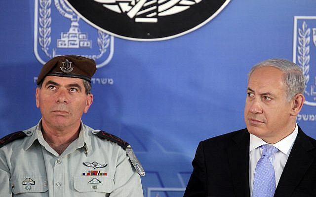 Prime Minister Benjamin Netanyahu, right, and then-IDF chief Gabi Ashkenazi, left, at the Prime Minister's office in Jerusalem, Feb. 14 , 2011. (Abir Sultan / Flash90.)