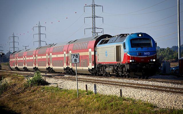Illustrative: A train pulling through the Hefer Valley, Israel. June 24, 2013. (Moshe Shai/FLASH90)