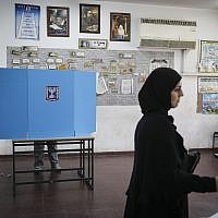 Illustrative: Arab-Israeli citizens cast their votes at a polling station in Ramla on elections day for the 20th Knesset, March 17, 2015. (Hadas Parush/Flash90)