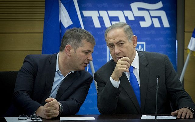 Prime Minister Benjamin Netanyahu and MK Yoav Kisch (L) converse during a Likud Party faction meeting at the Knesset on January 2, 2017. (Miriam Alster/Flash90)