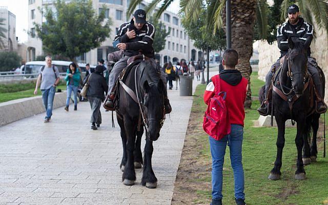 Illustrative: Mounted police  patrol near the Jaffa gate outside the Old City of Jerusalem, February 22, 2018. (Sasha Betzer/Flash90)