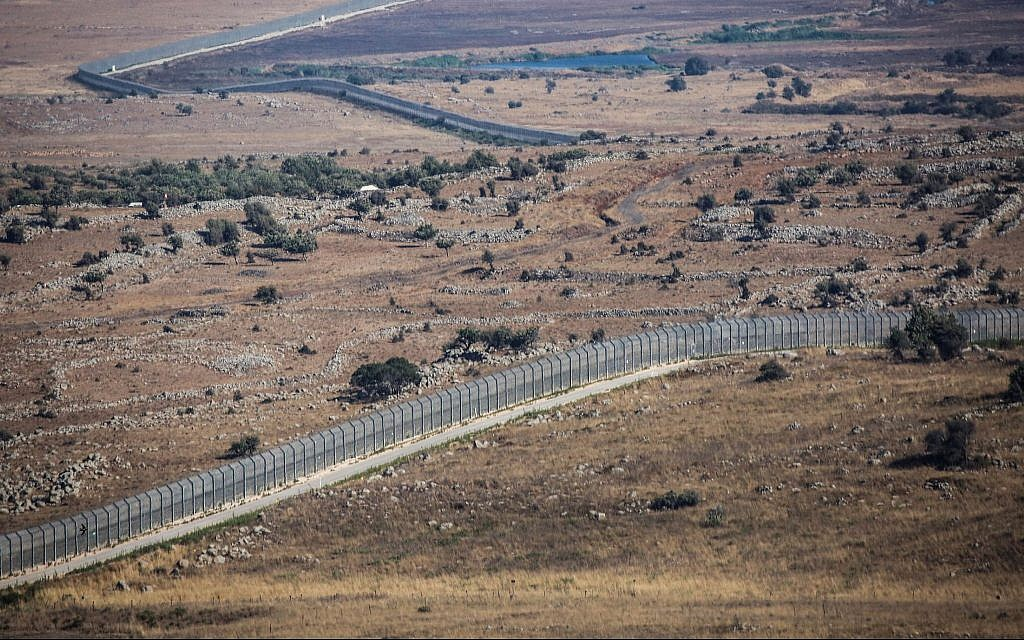 View of the border fence with Syria from the Israeli side in the Golan Heights, on July 23, 2018. (David Cohen/Flash90)