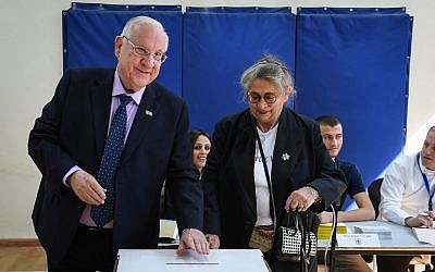 President Reuven Rivlin and his wife Nechama cast their ballots at a voting station on the morning of the municipal elections, on October 30, 2018, in Jerusalem. (Mark Neyman/GPO)