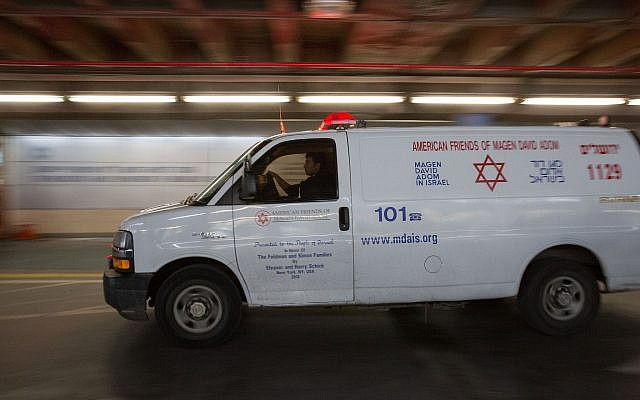 Illustrative: A Magen David Adom ambulance seen outside the Shaare Zedek hospital in Jerusalem, on December 13, 2018. (Noam Revkin Fenton/Flash90)