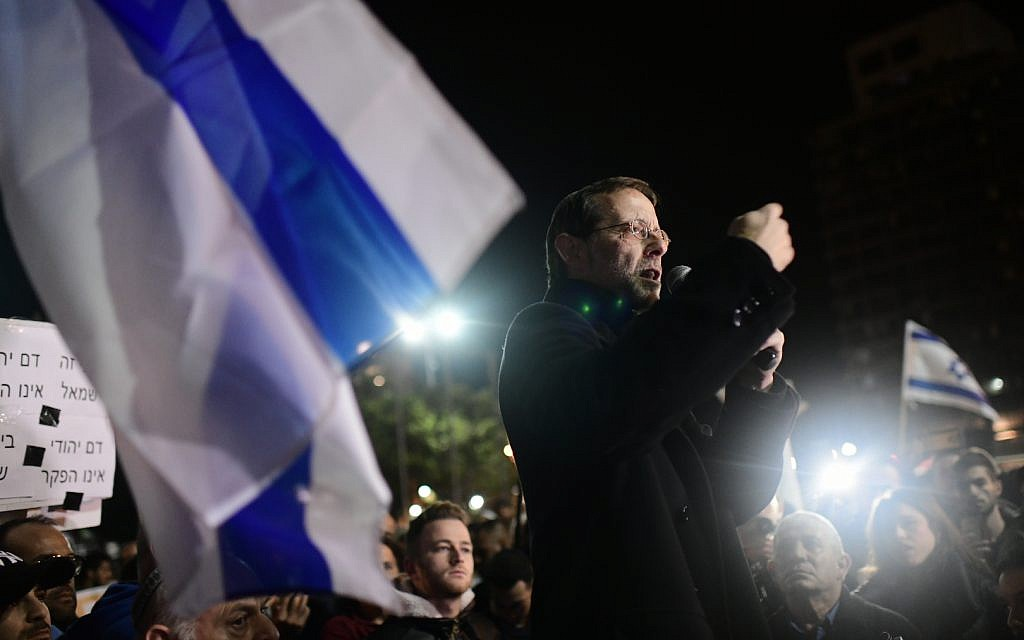 Zehut chairman Moshe Feiglin speaks during a demonstration held following the murder of 19-year-old Ori Ansbacher, in Rabin Square, Tel Aviv, February 9, 2019. (Tomer Neuberg/Flash90)