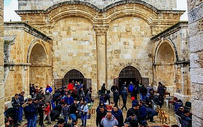 Palestinians take part in Friday prayers outside the Golden Gate, or Gate of Mercy entrance to the Temple Mount compound in Jerusalem's Old City, on March 1, 2019. (Sliman Khader/Flash90)