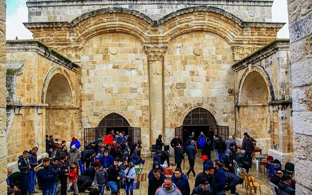 Palestinians take part in Friday prayers outside the Golden Gate in Jerusalem's Old City, on March 1, 2019. (Sliman Khader/Flash90)