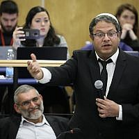 Members of the extremist Otzma Yehudit party, chairman Michael Ben Ari, left, and number two Itamar Ben Gvir, right, attend a meeting of the Central Elections Committee in the Knesset on March 6, 2019 to discuss appeals calling for Ben Ari's disqualification from running in the April Knesset elections. (Noam Revkin Fenton/Flash90)