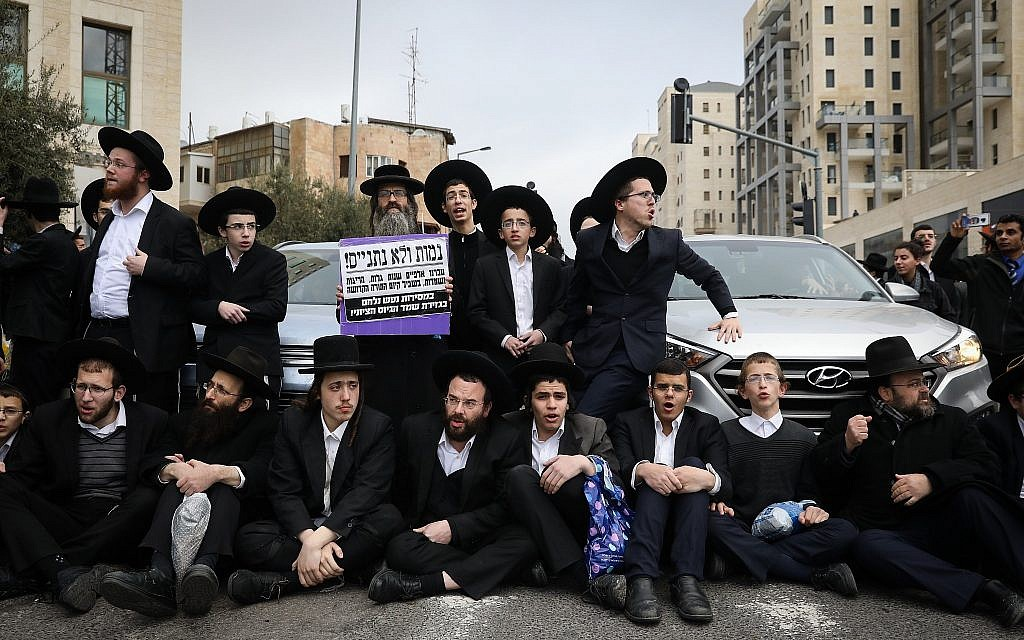 Ultra-Orthodox Jews protest in Jerusalem against the arrest of an ultra-Orthodox young man for draft-dodging on March 7, 2019. (Noam Revkin Fenton/Flash90)