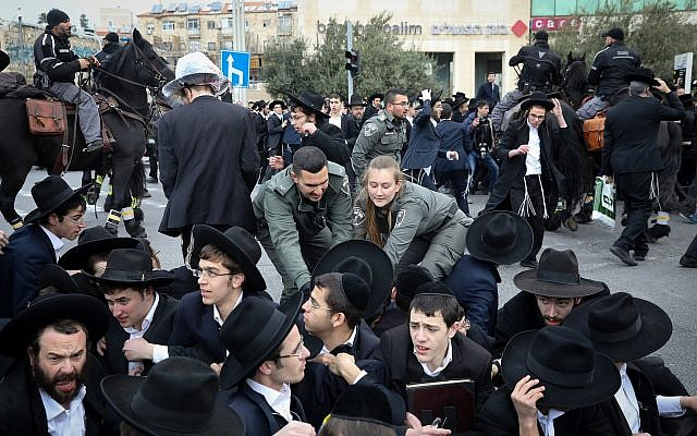 An ultra-Orthodox demonstration against the arrest of an IDF draft-dodger in Jerusalem on March 7, 2019. (Noam Revkin Fenton/Flash90)
