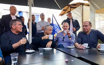 Left to right: Blue and White party leaders Gabi Ashkenazi, Yair Lapid, Benny Gantz and Moshe Ya'alon visit a shopping center in the southern port city of Ashdod on March 8, 2019. (Flash90)